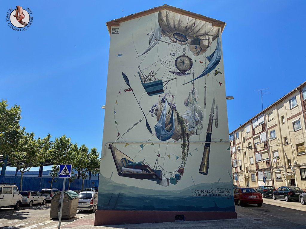 Arte urbano Zamora fachada alegoria educacion