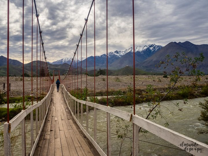 Landscape near Vicuña in Chile with a girl crossing a suspension bridge