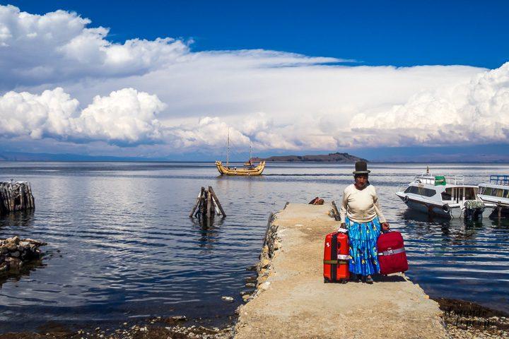 Cholita and totora boat in lake Titicaca Bolivia